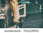 strength training in the gym   Shutterstock . vector #701225092
