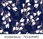 Stock vector magnolia flower vector illustration seamless pattern with white flowers on a navy blue background 701229082