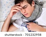 sick young man in the bed at... | Shutterstock . vector #701232958