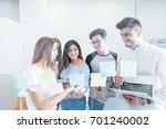 young men and women gathering... | Shutterstock . vector #701240002