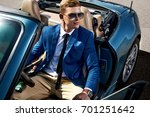 handsome man in the car ... | Shutterstock . vector #701251642