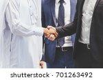 successful businessmen... | Shutterstock . vector #701263492