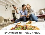 young couple enjoying eating... | Shutterstock . vector #701277802