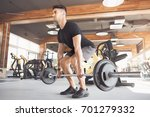 young man exercise in the gym... | Shutterstock . vector #701279332