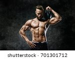 athletic man working out with a ... | Shutterstock . vector #701301712