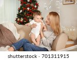 Happy Young Mother With Baby I...
