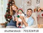 happy parents with baby in... | Shutterstock . vector #701326918