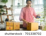 happy women packaging product... | Shutterstock . vector #701338702