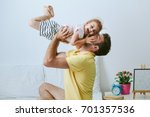 loving and caring dad playing... | Shutterstock . vector #701357536