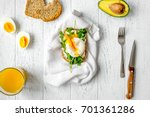 sandwich with poached eggs on... | Shutterstock . vector #701361286