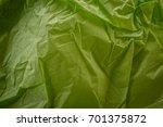 crumpled green paper background | Shutterstock . vector #701375872