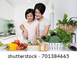 young asian mother and daughter ... | Shutterstock . vector #701384665