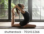 young woman practicing yoga ... | Shutterstock . vector #701411266