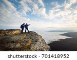 Two Climbers Standing On Top Of ...