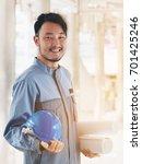 portrait of happy engineer....   Shutterstock . vector #701425246