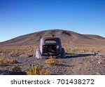 a rusty old abandoned car in... | Shutterstock . vector #701438272
