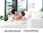 young asian mother and daughter ... | Shutterstock . vector #701439532