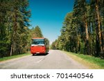 red bus in motion on country... | Shutterstock . vector #701440546