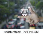 shopping cart icon on finger