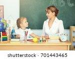 cute schoolgirl and her teacher ... | Shutterstock . vector #701443465