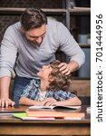 young father helping little... | Shutterstock . vector #701444956