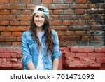 young stylish woman in jeans... | Shutterstock . vector #701471092