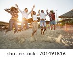 group of friends on beach... | Shutterstock . vector #701491816