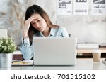 businesswoman looking at laptop ... | Shutterstock . vector #701515102