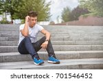handsome young man sitting... | Shutterstock . vector #701546452