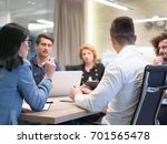 group of a young business... | Shutterstock . vector #701565478