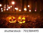 two kind halloween pumpkins in... | Shutterstock . vector #701584495