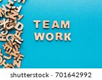 word teamwork on blue... | Shutterstock . vector #701642992