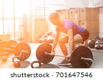 dedicated man lifting barbell... | Shutterstock . vector #701647546