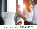 Small photo of employee smiling after business people standing ovation applauding a good presentation in the office