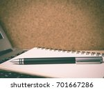 pen and notebook on laptop with ... | Shutterstock . vector #701667286