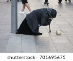 a beggar asking alms.the old... | Shutterstock . vector #701695675