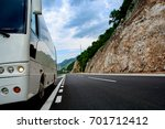 tourist bus on a mountain road | Shutterstock . vector #701712412