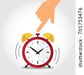 hand turns off red alarm clock. ... | Shutterstock .eps vector #701753476