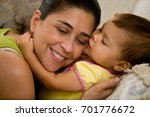 mother smiling as daughter... | Shutterstock . vector #701776672