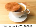 stroopwafel placed on top of... | Shutterstock . vector #701783812