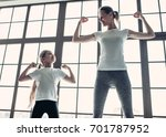 attractive young mom with her... | Shutterstock . vector #701787952
