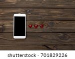smartphone  heart figures on a...   Shutterstock . vector #701829226