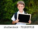 school kid holding a blackboard ... | Shutterstock . vector #701839918