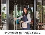 waiter welcoming customer to... | Shutterstock . vector #701851612
