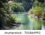 jordan river  place of baptism | Shutterstock . vector #701864992
