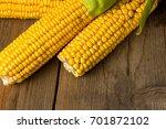 ripe yellow sweet corn cob on a ... | Shutterstock . vector #701872102