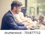 businessman using laptop for... | Shutterstock . vector #701877712