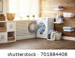Stock photo interior of a real laundry room with a washing machine at the window at home 701884408