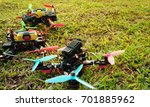three racing drone on green... | Shutterstock . vector #701885962