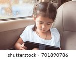 cute asian child girl using... | Shutterstock . vector #701890786